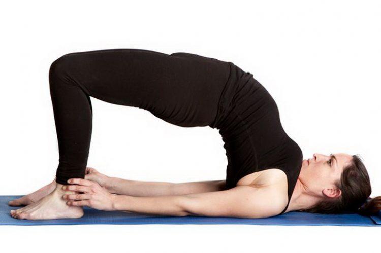 Поза йоги Сетубандхасана